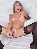 Horny mature lady playing with her toy